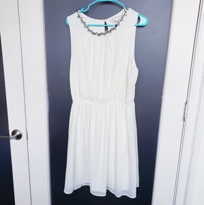 Ivory knee length dress with rhinestone neckline